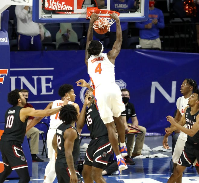 Florida's Anthony Duruji sails in to dunk the ball on an out-of-bounds play Wednesday against South Carolina at Exactech Arena.
