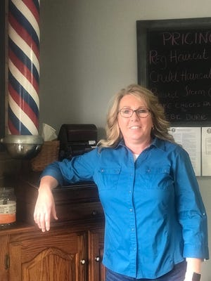 Debi Hostetler-Durr is the owner of Hostetler's Barber Shop in Newcomerstown.