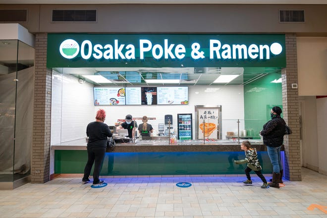 Customers wait for their orders at Osaka Poke and Ramen in the Pueblo mall on Thursday February 4, 2021.