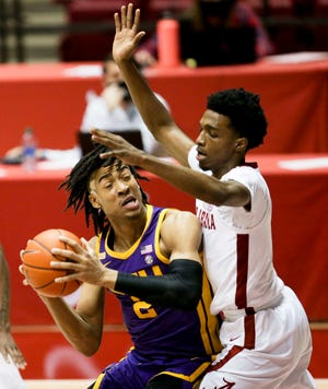Alabama forward Herb Jones (1) defends as LSU forward Trendon Watford (2) attempts to drive into the lane in Coleman Coliseum Wednesday, February 3, 2021. [Staff Photo/Gary Cosby Jr.]