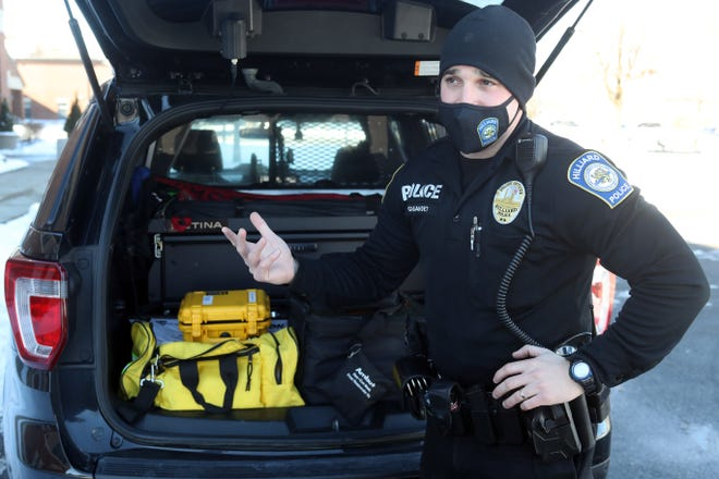 Hilliard Division of Police officer Dustin Gigandet on Feb. 3 describes the automated external defibrillators that now are being carried in each Hilliard cruiser.