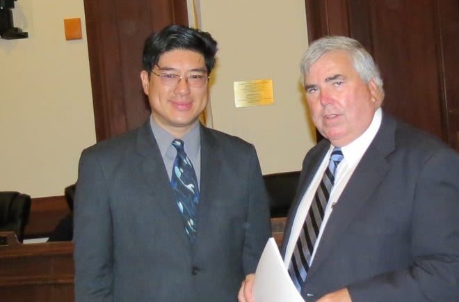 State Rep. Tackey Chan, left, worked with District Attorney Michael W. Morrissey on legislation expanding the state expungement statute that was signed into law on New Year's Eve. The change eliminates barriers to employment and training for people who made a single mistake in their youth.