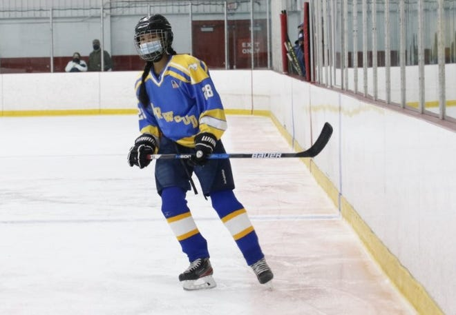 Randolph High School freshman Lily Dinh didn't let the lack of a high school hockey team stop her from playing on the ice. After her final year playing youth hockey in Norwood (shown), she's been able to play with the Stoughton/Sharon high school team this year.