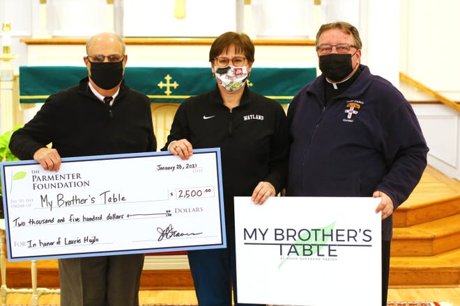 From left, Thomas S. Travers, co-president of The Parmenter Foundation's Board of Trustees, Laurie Hojlo, director of My Brother's Table, and Fr. Dave O'Leary of Good Shepherd Parish in Wayland.
