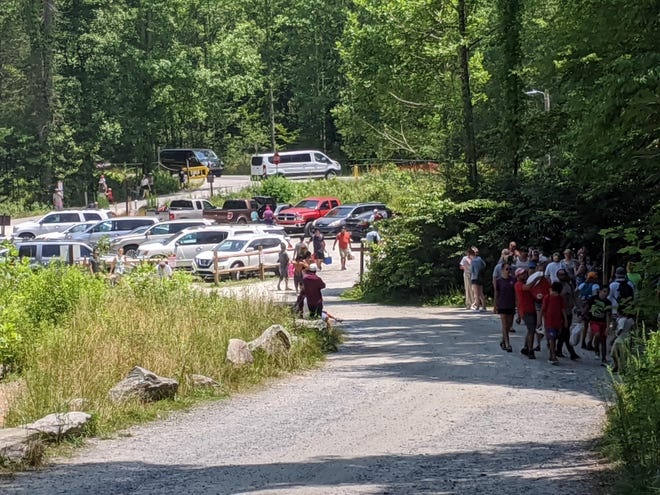 Last year a record number of visitors filled the parking lot at Hooker Falls, the mot popular destination in DuPont State Recreational Forest.