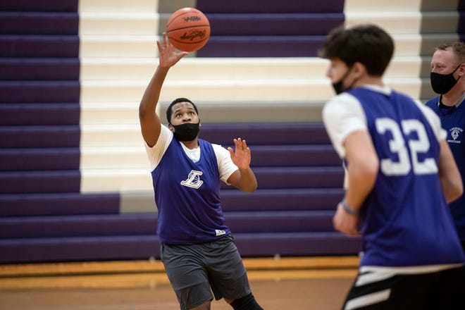 Lakeview senior Clyde Sanders II catches the ball during practice on Thursday, Feb. 4, 2021 at Lakeview High School in Battle Creek, Mich. Gov. Gretchen Whitmer announced Thursday that indoor contact sports may resume.