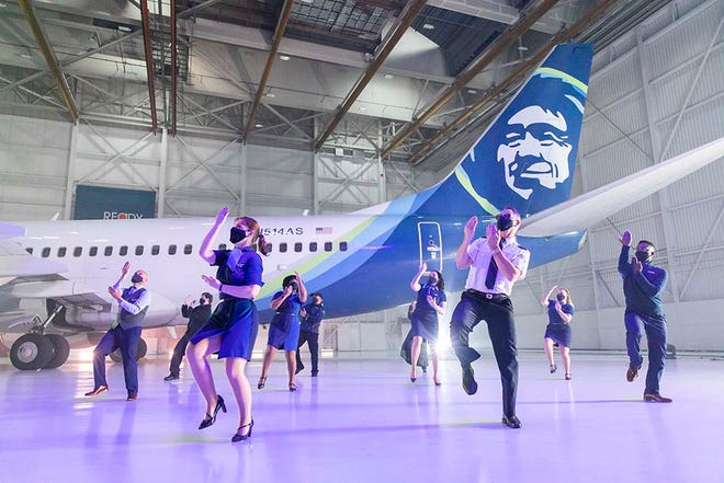 Bainbridge Island's Patrick Miller, front center, a pilot with Alaska Airlines, dances during filming for the company's Super Bowl ad.