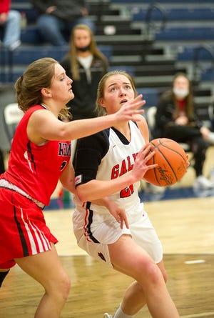 Galion's Natalee Perkins drives to the basket around Bucyrus' Addison Ricker.