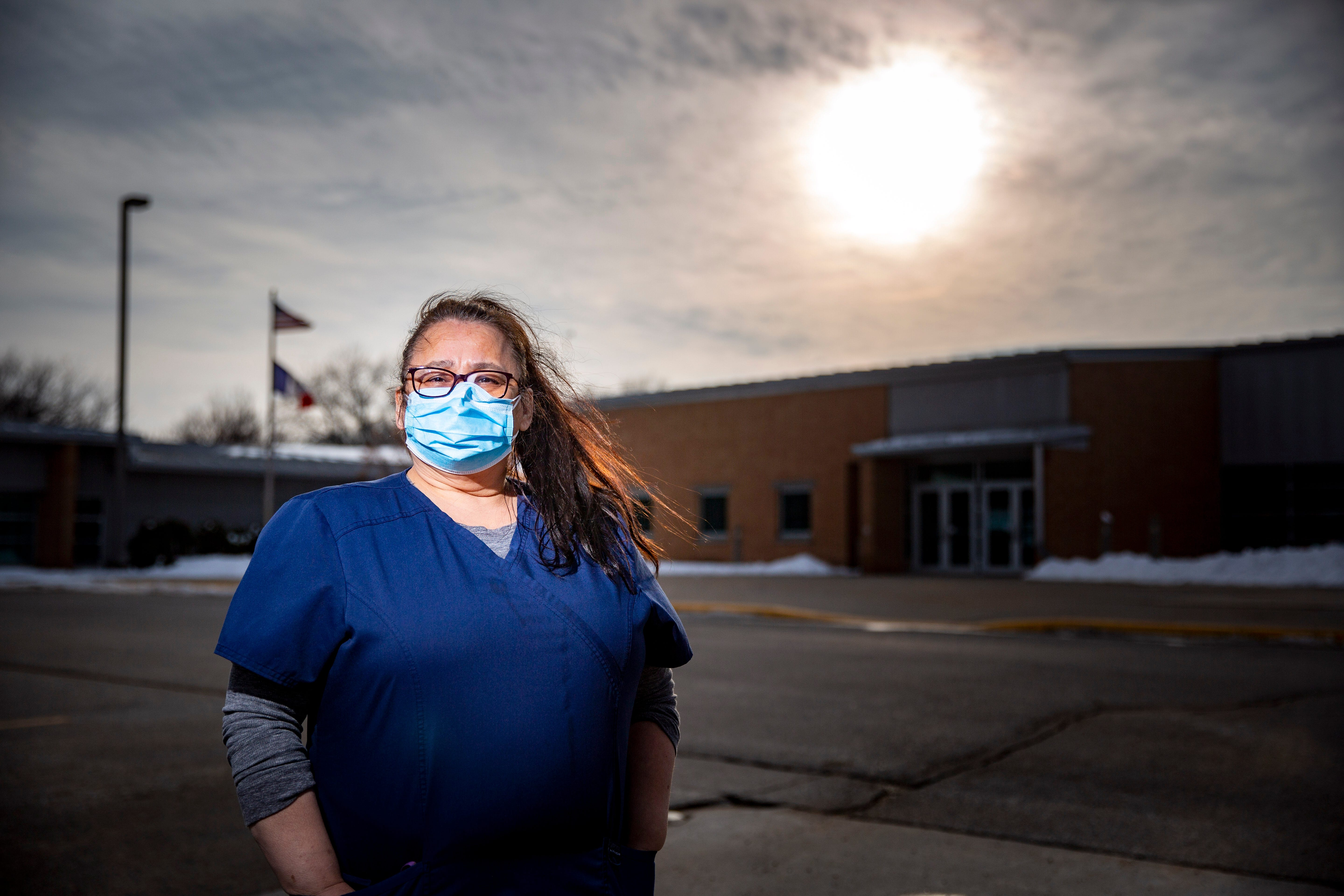 Mary Embrey stands for a photo at Webster City Middle School after a day of teaching Wednesday, Feb. 3.
