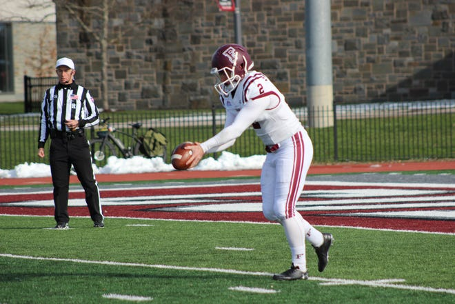 Andrew Mevis punting while playing for Fordham and before transferring to Iowa State
