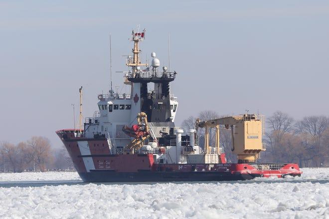 A U.S. Coast Guard Cutter makes its way past Marine City Michigan on the St. Clair River on Feb. 4, 2021.