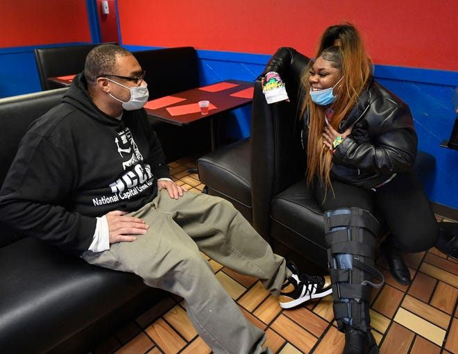 Larry D. Smith Jr. is reunited with his daughter Eakira Bullard, 28, at D's Coney Island in Detroit, Michigan on February 4, 2021.