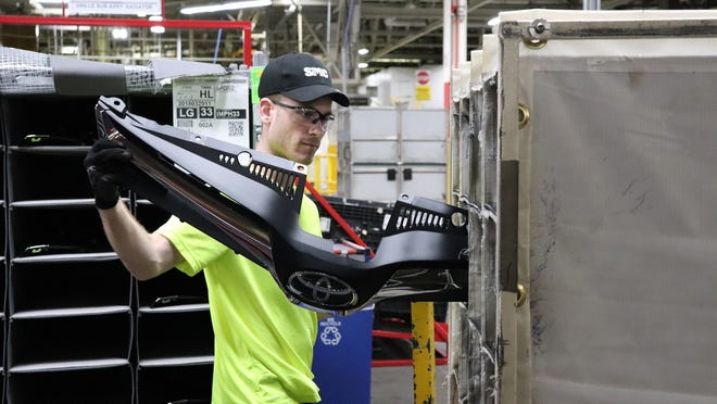 Zach Brown, son of TMMI's Ted Brown, was born with spina bifida. But that hasn't prevented the 23-year-old from finding a place of productivity at the plant.