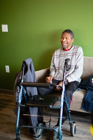 Walter Roberts, 65, sits in his new apartment at Mason Place, 60 units for people with disabilities who were previously homeless.