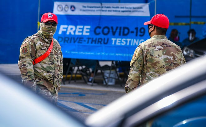 Guam Army National Guard's 254th Red Horse Squadron members assist motorists attending free COVID-19 testing, offered by the Department of Public Health and Social Services, during a drive-through outreach at the Yigo gymnasium on Thursday, Feb. 4, 2021.
