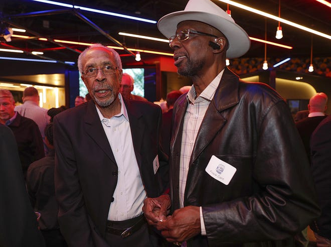 Donnie Freeman, left, talks with Frank Card, right, during the ABA 50th anniversary reunion at Bankers Life Fieldhouse on Saturday, April 7, 2018.