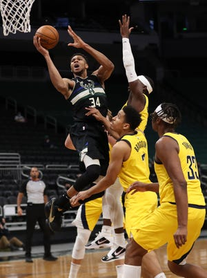 Feb 3, 2021; Milwaukee, WI, USA; Milwaukee Bucks forward Giannis Antetokounmpo (34) shoots against the Indiana Pacers at the Bradley Center.  Mandatory Credit: Nick Monroe/Handout Photo via USA TODAY Sports