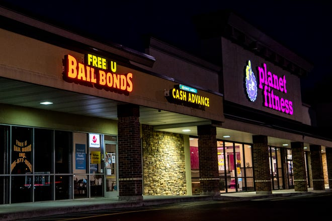 Free U Bail Bonds, at left, in a strip mall along Chapman Highway in South Knoxville on Wednesday, February 3, 2021. Free U Bail Bonds is one of many bail bond companies found across Knox County.