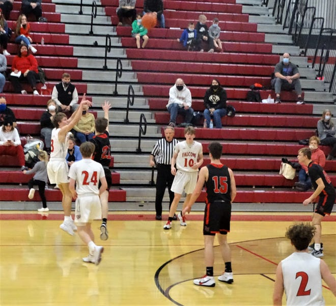 Fairfield Union senior Ryan Magill shoots a deep 3-pointer Wednesday night against visiting Liberty Union. Magill hit the game-winning shot at the buzzer to give the Falcons a 54-53 win.