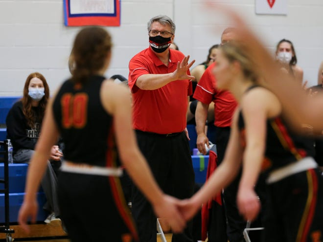 Bullitt East head coach Chris Stallings instructs his team against Sacred Heart during their game at Sacred Heart Academy on Feb. 3, 2021.