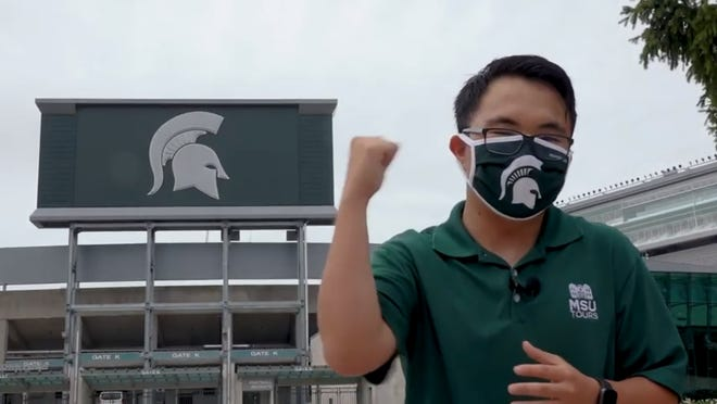 A screenshot shows a student with Michigan State University Tours introduces Spartan Stadium as part of a virtual tour of campus. MSU officials have focused on online recruitment efforts as a result of COVID-19.