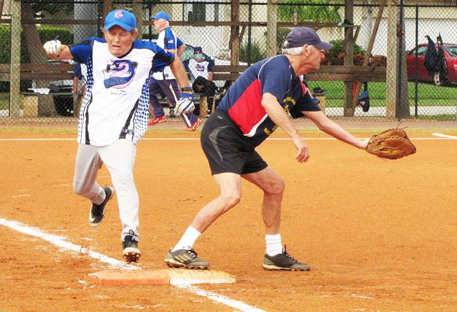 Crazy Flamingo's Bill Moors lunges to first base for a base hit beating the throw to American Legion's Al Bozzo.