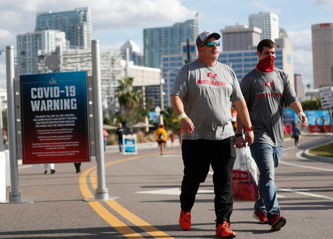 National Football League fans convene in downtown Tampa ahead of Super Bowl LV during the COVID-19 pandemic on January 30, 2021 in Tampa, Florida. The Tampa Bay Buccaneers will play the Kansas City Chiefs in Raymond James Stadium for Super Bowl LV on February 7.