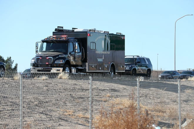 A New Mexico State Police mobile command post is stationed near the Motel Boulevard exit off Interstate 10 on Thursday, Feb. 4, 2021. A multiagency investigation is underway after a state police officer was shot and killed.