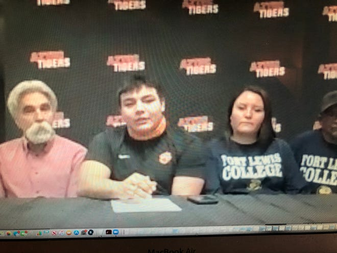 Aztec's Caleb Varzeas signs his National letter of intent via Zoom on Wednesday, Feb. 3, 2021, to continue his football career at NCAA Division II Fort Lewis College.