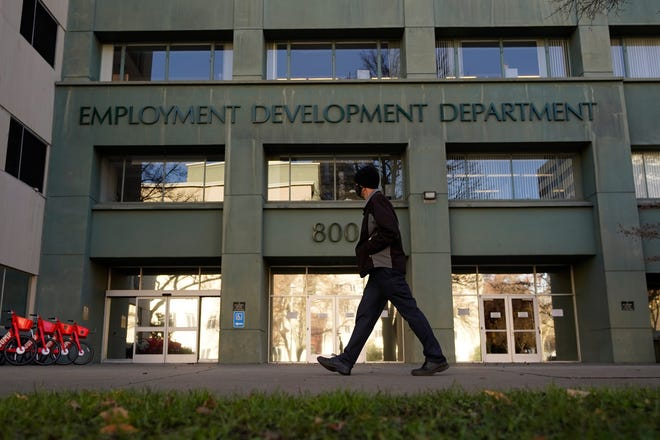 A person passes the office of the California Employment Development Department in Sacramento, Calif., on Dec. 18, 2020.