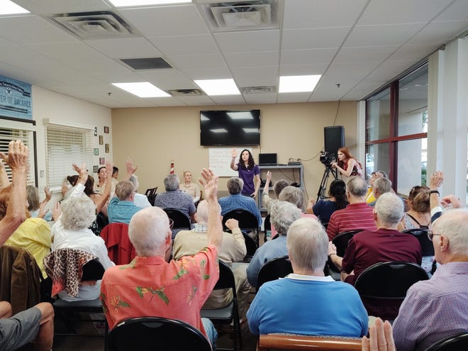 Pre-COVID, personal trainer Kristi-Lynn Lake leads a guided breathing exercise to Club Journey participants.