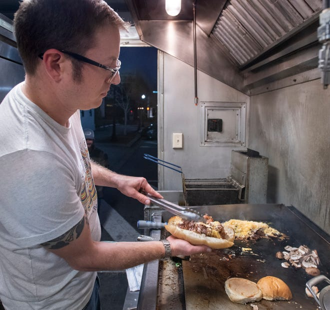 Chef/Owner Eric Pommerening prepares a Brisket/Green Chili Cheesesteak at Two Birds Street Food truck outside Odd Colony Brewing Company in downtown Pensacola on Wednesday, Feb. 3, 2021.