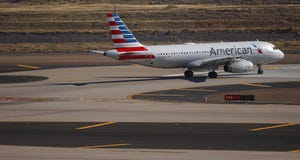 An American Airlines flight waits for takeoff at Phoenix Sky Harbor Airport on Feb. 4, 2021.