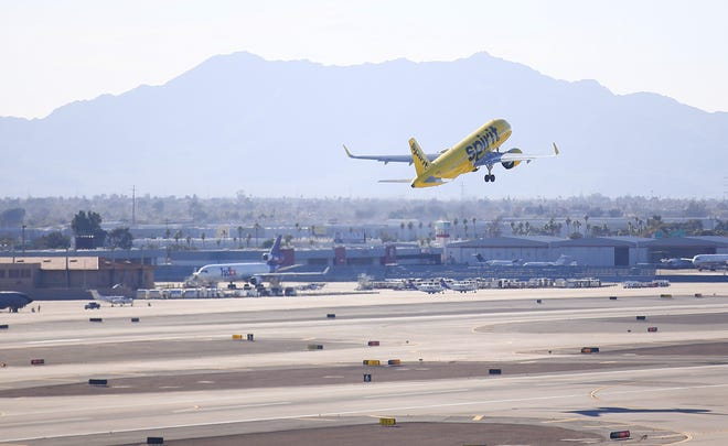 A Spirit Airlines plane takes off at Phoenix Sky Harbor Airport on Feb. 4, 2021.