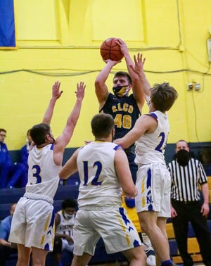 Elco's Braden Bohannon goes up for a short jumper as the Vikings' Peyton Wolfe, Ian Herman and Nate Shirk defend.