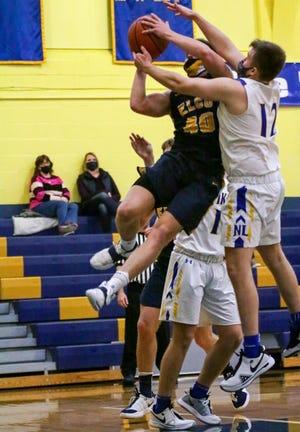 Elco's Braden Bohannon attacks the basket against Northern Lebanon's Ian Herman.