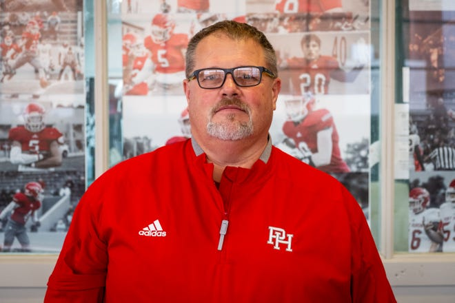 Port Huron High School head football coach Dan Perkins poses for a portrait Thursday, Feb. 4, 2021, in the weight room at the school. Perkins replaced former coach Ryan Mullins after he retired earlier this season.