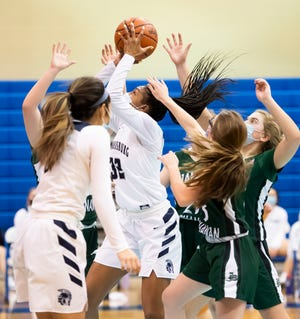 Chambersburg's Ahsia Thomas scores off a rebound during play against James Buchanan in Chambersburg on Wednesday, February 3, 2021. The Trojans won, 55-42.