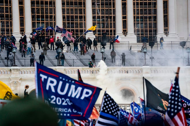 Supporters of President Donald Trump clash with the U.S. Capitol police during a riot at the U.S. Capitol on Jan. 6, 2021, in Washington, D.C. (Alex Edelman/AFP via Getty Images/TNS)