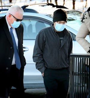 Mark Crone arrives with his attorney, Farley Holt, left, for his preliminary hearing before District Judge Tom Reilly Thursday, Feb 4, 2021, at Reilly's North Codorus Township office. Bill Kalina photo