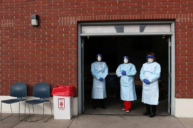 Washoe County public health nurses wait to test people for Coronavirus in Reno on March 7, 2020.