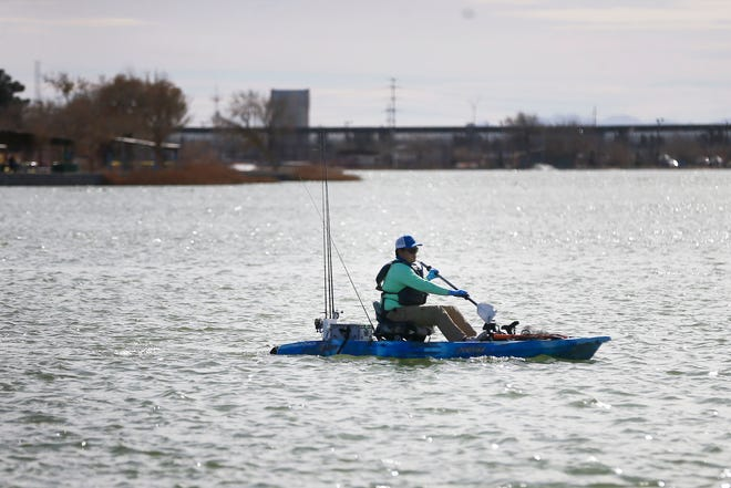 Danny Sigala fishes on Ascarate Lake on Wednesday, Feb. 3, 2021, in El Paso. Sigala was fishing before the lake was restocked with trout.