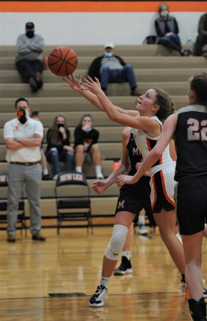 New Lex's Emma Abrams lays the ball up in Wednesday's 50-40 win. The Panthers claimed the MVL Small School Division title, the program's first league title in 20 years.