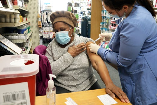 Doryl Wolfe, 76, of Cortlandt Manor receives her first dose of the COVID-19 vaccine from Christina Gilkes at Save Mor Drugs in Croton-on-Hudson Feb. 4, 2021.