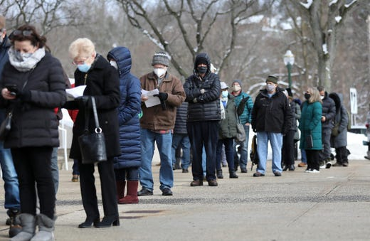 People with appointments for the COVID-19 vaccine wait on line at the Westchester County Center in White Plains on Wednesday, February 3, 2021. Appointments scheduled for the past two-days were rescheduled for today due to the inclement weather.