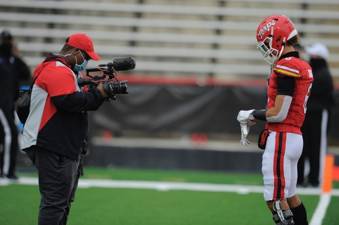 Alex Grant capturing a video of Terrapins WR Jeshaun Jones at Capital One Field at Maryland Stadium.
