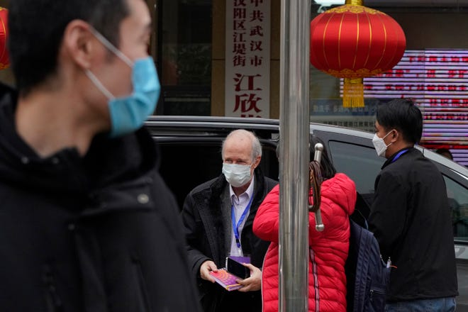 A member of the World Health Organization team arrives for a field visit at the Service Center for Party Members and Residents of Jiangxinyuan Community in Wuhan, China,  Feb. 4, 2021.