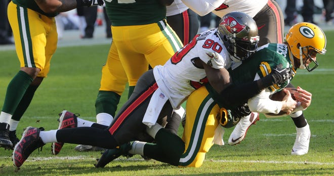 Buccaneers outside linebacker Jason Pierre-Paul sacks Green Bay Packers quarterback Aaron Rodgers in the the NFC championship game