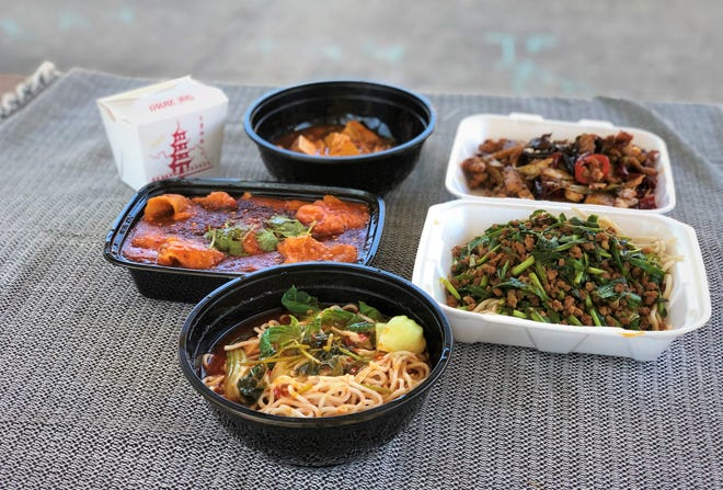 A picnic spread with dishes from, clockwise from front center, Asia Market Eatery, Asia Cafe, Fat FDagon, A+A Sichuan and Chen's Noodle House, which are all located in the shopping center at Spicewood Springs Road and U.S. 183.