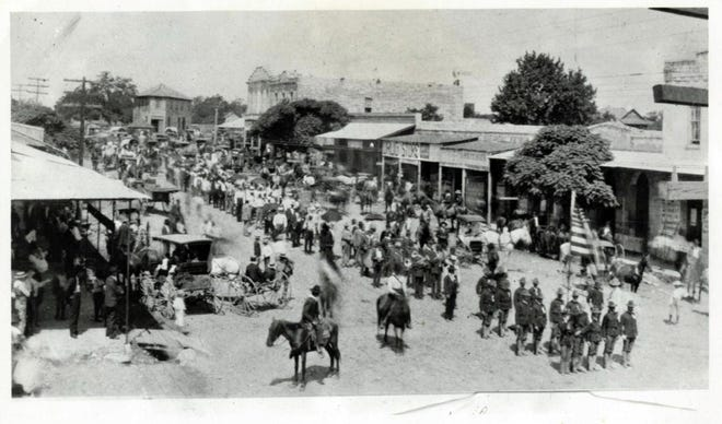The American-Statesman often localized war coverage with human interest stories about area soldiers. This image by an unknown photographer, which did not appear in the Statesman, shows Spanish-American War soldiers parading in Round Rock, likely in 1898.